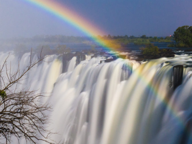 Zambia, view of the Eastern Cataract of Victoria Falls, taken at night showing rainbow created by the moon, or Moonbow, during high water, at full moon, in June 2009 © David Rogers